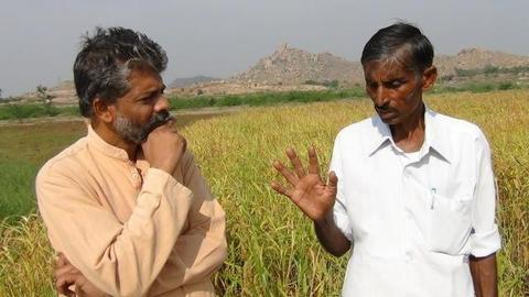 Farmer with Dinesh in Earth360 at his farm
